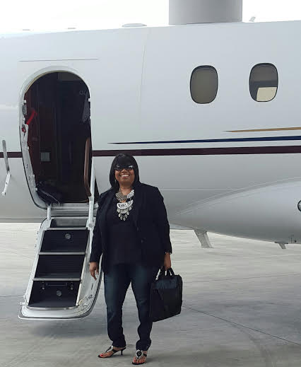 Sandra getting on private plane